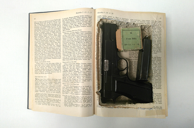 Kiswahili bible with 9mm gun, 1960s